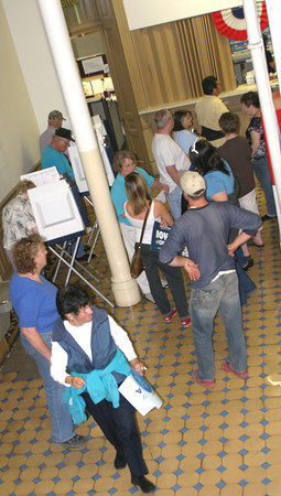 Citizens line up Thursday at the Wapello County Courthouse to be among the first in the nation to cast their votes in the federal election. One large group met at Democratic Headquarters to walk to the auditor's office together.