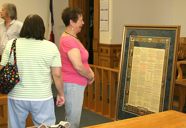 Helen Epperson of the Wapello County Democratic Central Committee celebrates her group's purchase of an 80 year-old copy of the U.S. Constitution on Tuesday. The document, which they have donated to the county, will hang in the Wapello County Courthouse.