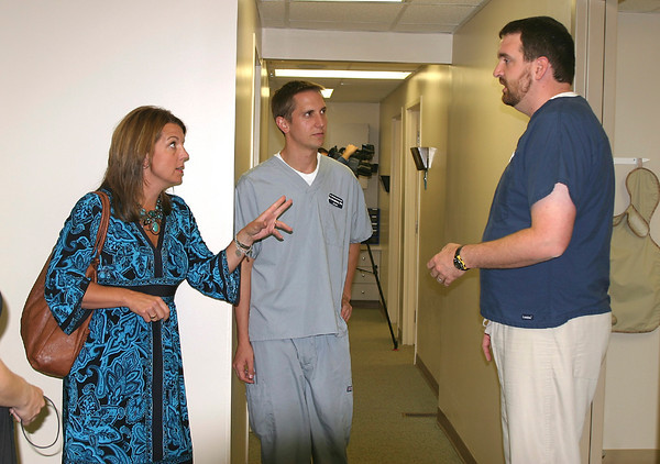 Suzanne Heckenlaible of the Delta Dental of Iowa Foundation talks to Drs. Joseph Dougherty and Ed Dye about the newly renovated dental offices at River Hills Community Health Center downtown. The office has increased its patient capacity. <br /> Mark Newman
