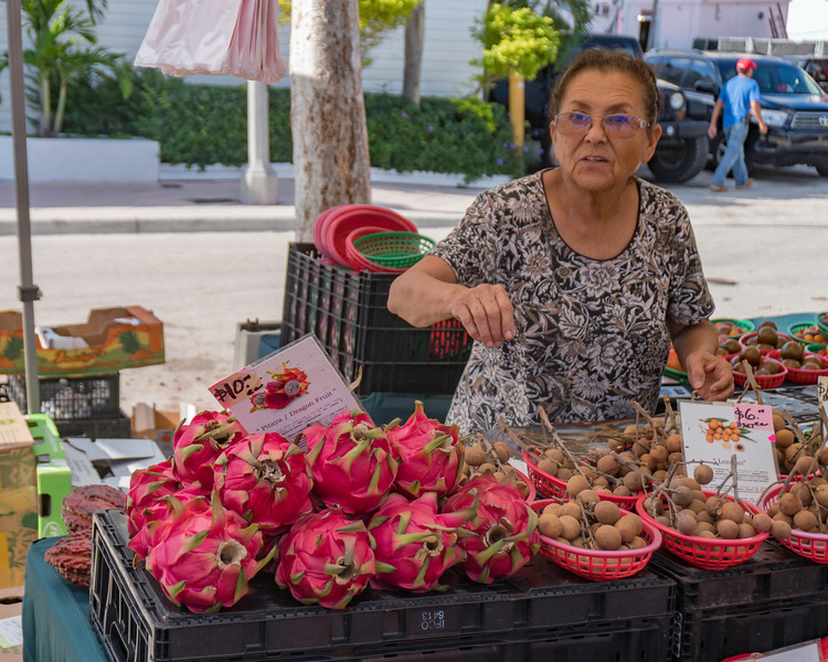 Woman selling Dragon Fruit - Gloria Fine