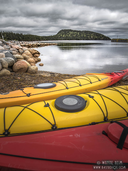 Kayaks Await    Photography by Wayne Heim
