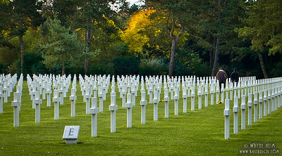 Perspective - WW II Cemetery in France showing the white crosses to commemorate those who died in World War II. ©Wayne Heim