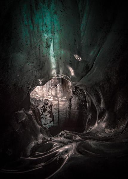 Cold Inside Glacier Cave   Photography by Wayne Heim