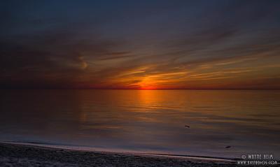 Setting Sun on Lake    Photography by Wayne Heim