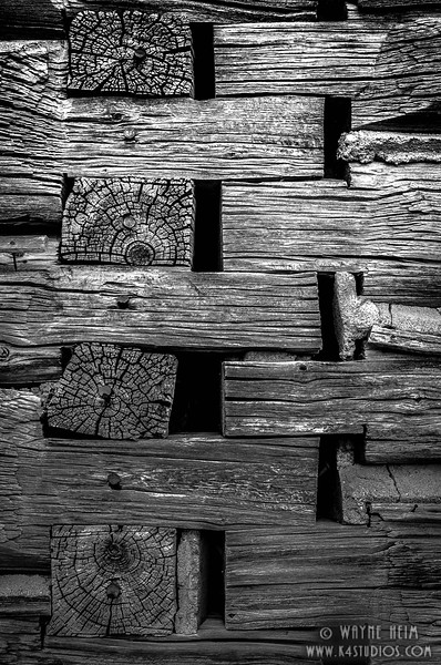 Meshing Logs - Black & White Photography by Wayne Heim