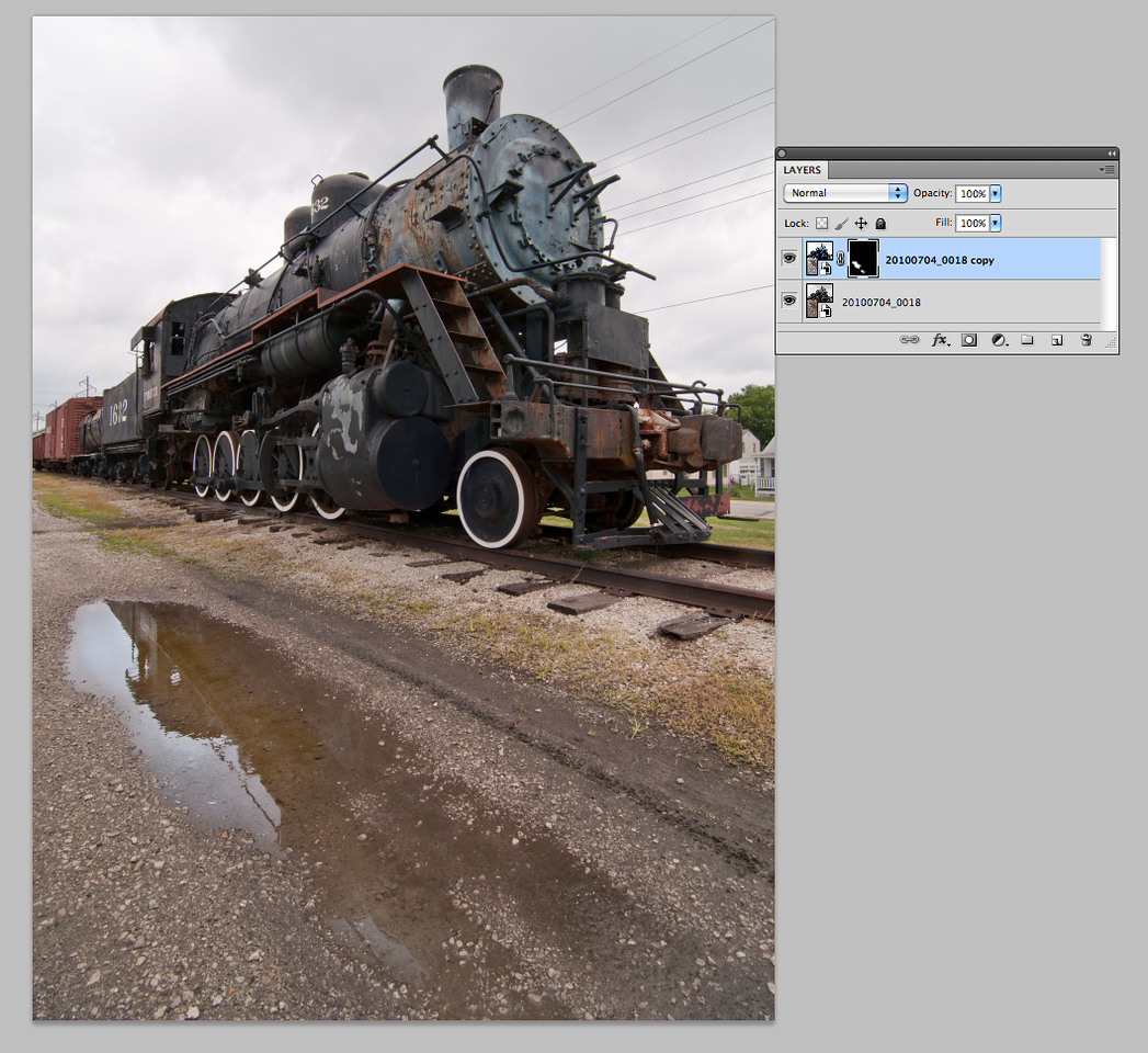 Back in Photoshop a layer mask has been added to the Smart Object copy. The mask hides everything but the puddle.