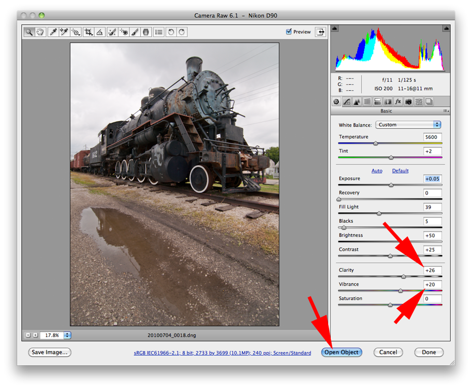 A couple final tweaks before moving into Photoshop. First the <i>Clarity</i> adjustment is used to add contrast to the mid tones and makes them appear a little sharper. Second the <i>Vibrance</i> adjustment is used to add a bit of pop to the colors. Although the locomotive looks pretty good, the reflection in the puddle looks horrible. Its flat (not much contrast) and an awful muddy brown. By opening the image in Photoshop as a <i>Smart Object</i> a second Camera Raw conversion can be done later to get the puddle looking better. Hold down the <i>Shift</i> key and the Camera Raw <i>Open Image</i> button will change to <i>Open Object</i>. Clicking on <i>Open Object</i> opens the current image in PS as a Smart Object.