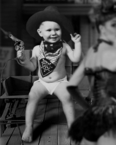 Photo: Unknown Photoshop: Tom Jenkins Baby Face Miner Original photo was the hat, scarf, and baby in diaper