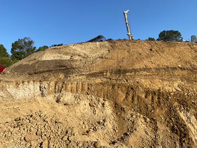 Looks like an offset soil horizon at the recently active scarp. July, 2021