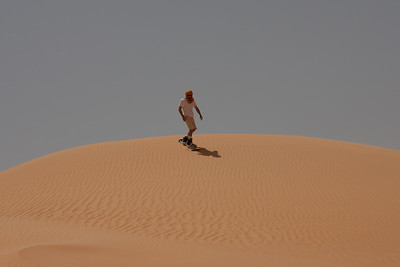 Sand dune skiing in the Sahara desert