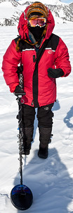 Nancy Miller at the site of her first discovery detects the meteorite under the ice