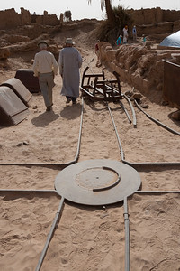 A turntable for a small gage railroad that is being used in tomb restoration