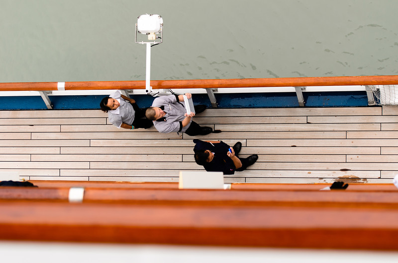 Some crew members were out on deck taking pictures.