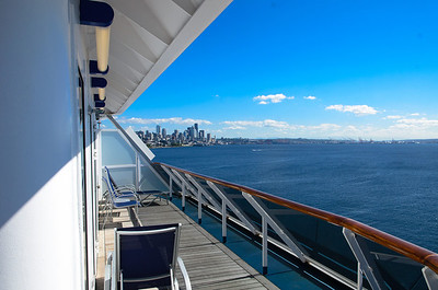 Standing on the balcony of room 8268 on the Carnival Spirit, with Seattle, WA in the background.