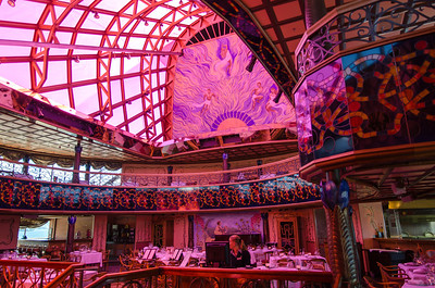 This is inside the steak house on the Carnival Spirit. This restaurant is located on decks 10 and 11 underneath the whale tail. The red colored glass ceiling adds a beautiful tint to the room.