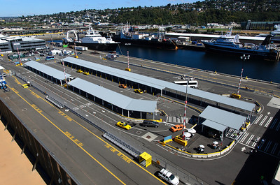 Looking down at the drop-off/pick-up area of Pier 91 in Seattle, WA. A steady stream of taxis and shuttles ferried roughly 2000 people to the Carnival Spirit for our cruise to Alaska. This port is a good distance north of downtown and requires vehicle transportation to get to.