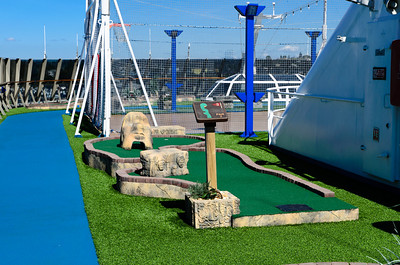 On deck 11 of the Carnival Spirit there is mini golf and a basketball court surrounded by a jogging track.