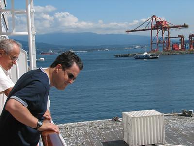 Joe and dad looking at the tug boats