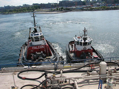 Tug boats holding the refueling barge in place