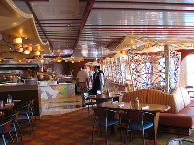 """Here we are walking on the Lido deck (deck 9) of the Carnival Spirit.  The Lido deck is also known as the """"party"""" deck as it contains two swimming pools, three hot tubs, and lots and lots of food."""
