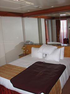 The king size bed in the seperate bedroom transforms into two twin beds.