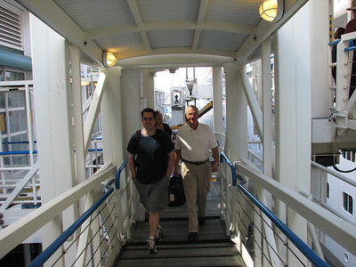 Joe and dad walking the plank to get on the ship.