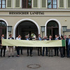 Representatives from different conservation organisations holding up a banner showing how large (small) the goal of having 5% of of the forests in Hessen Protected. Parlamentarischer Abend, Hessen - Land der Naturwälder, Hessischer Landtag. Wiesbaden, Hessen, Germany. © Daniel Rosengren