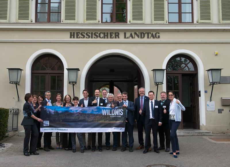 Representatives from different conservation organisations holding up a banner. Parlamentarischer Abend, Hessen - Land der Naturwälder, Hessischer Landtag. Wiesbaden, Hessen, Germany. © Daniel Rosengren