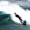 """Surfing in the waters of Huntington Beach, which is said to have the most """"consistent"""" waves in California."""