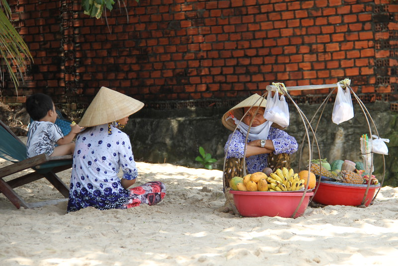 The ubiquitous beach fruit sellers