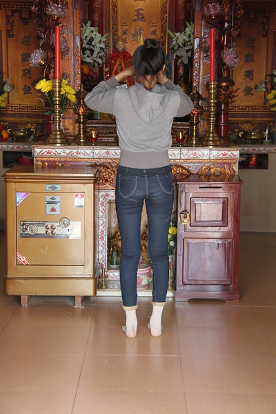 Young girl praying inside the temple