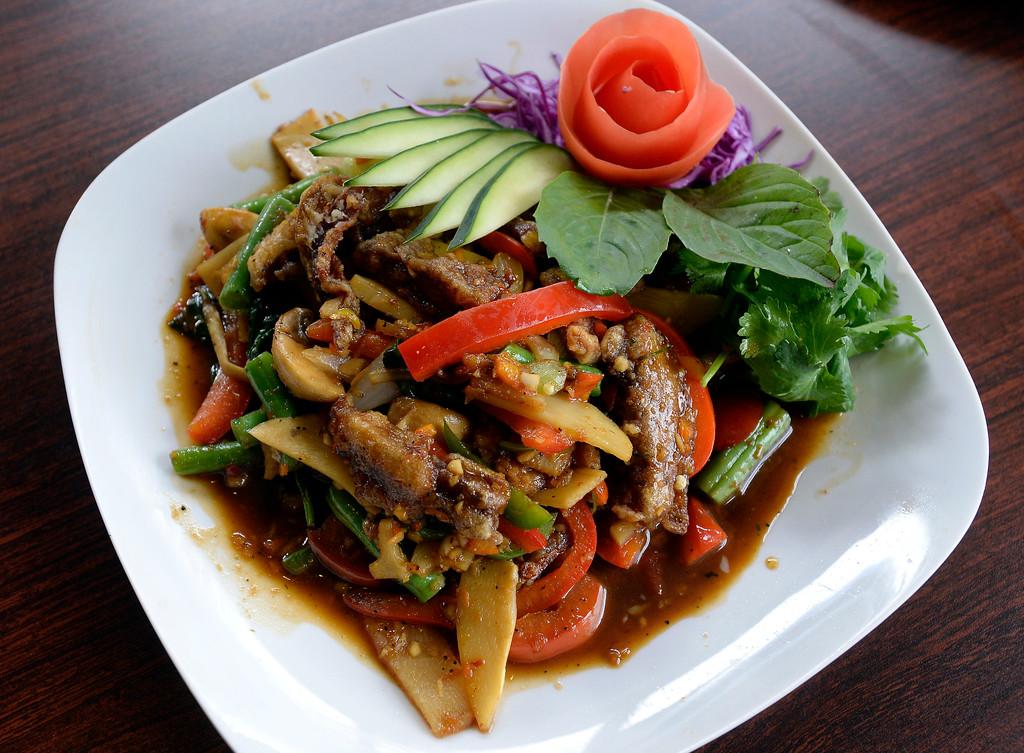 . Crispy duck basil stir fry entrée from Phuket Thai Restaurant in Louisville. Cliff Grassmick  Photographer November 1, 2017
