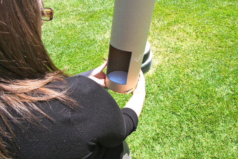 Another model we built has the Sun appearing on white poster board.  The peep hole in the side allows us to observe the Sun (and the eclipse).  This is what the following pictures display.