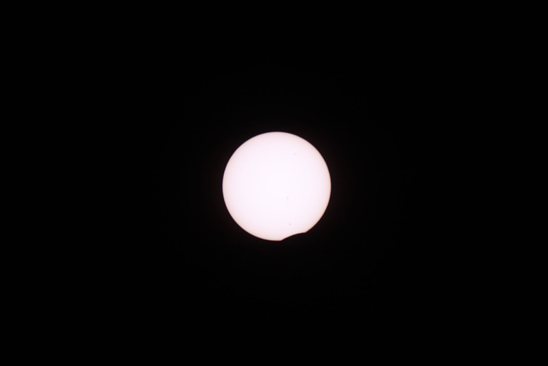 Just after the first contact.  The moon is making its way in front of the Sun.