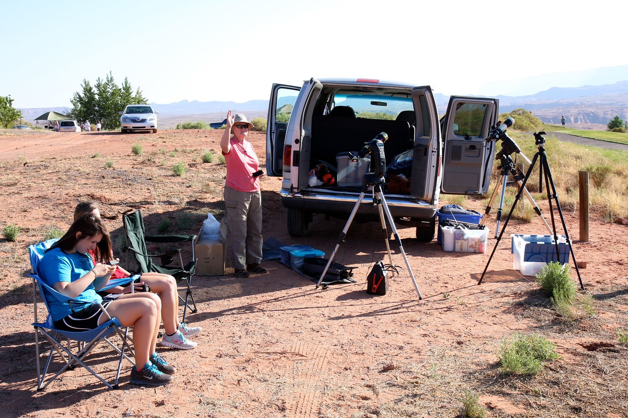 Hanging out on a hill overlooking Page, AZ just before the eclipse.  We have a Coronado solar telescope (behind van) and a Televue85 equipped with a solar filter and camera (near the passenger door).