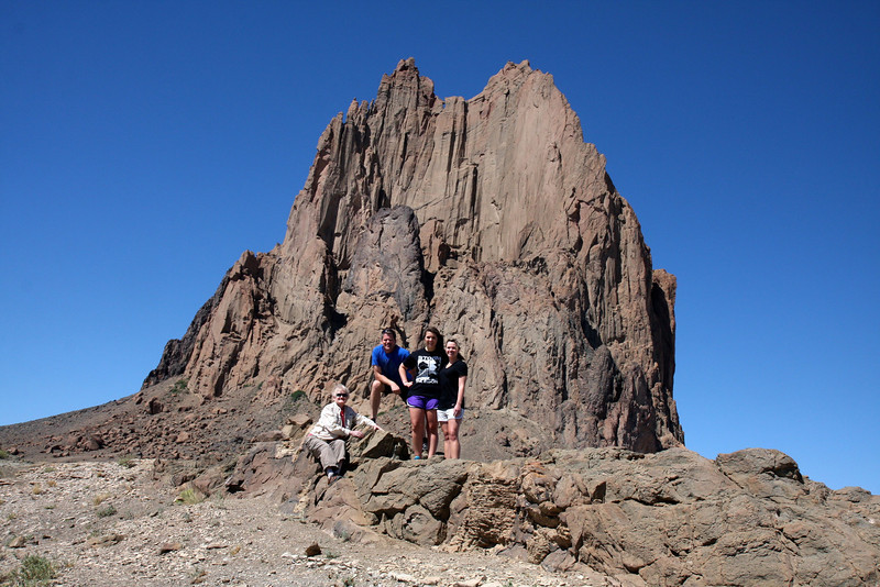 In front of Shiprock, NM - this is an old volcanic neck when the region was volcanically active about 30 million years ago.  The current height above the plane is 1100 feet.  The rest of the volcano has eroded away leaving behind the harder basaltic rock.