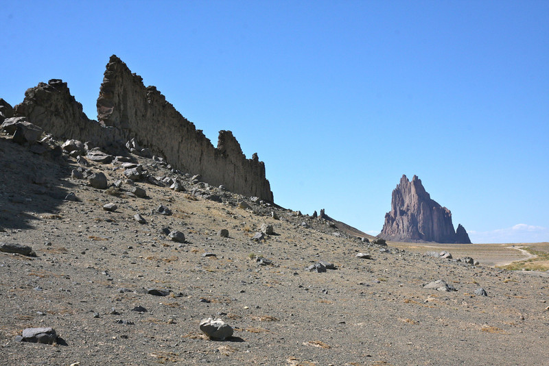 Shiprock in the background - the dike from the volcano makes its way towards us.  Again, the material in which the dike was formed has all eroded away.