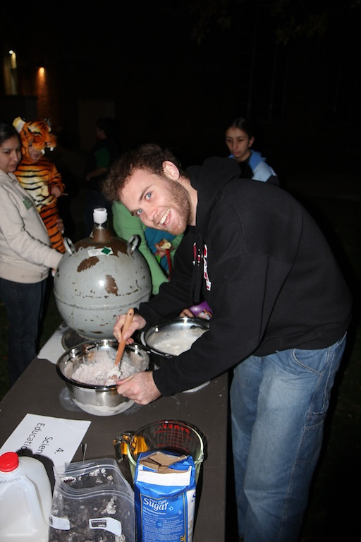 The physics groups helps with fall fest.  Alex Henderson stirs up some frosty liquid nitrogen ice cream.