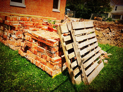 Brick recycling at the Fiji house demolition.