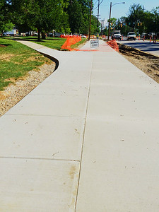 shiny new sidewalk near Shriver Center.