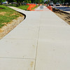 shiny new sidewalk near Shriver Center.