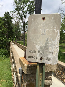 This sign has seen better days. Western Campus Bridges. Miami University.
