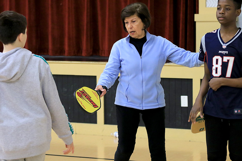 Kids at the Boys and girls club of Fitchburg and Leominster learned about the game of pickleball from some volunteers that love to play. Volunteer Maria Sullivan explains the game to Sylas Herndon, 11, from Leominster and Selasi Sampedey, 12, from Leominster. SENTINEL & ENTERPISE/JOHN LOVE