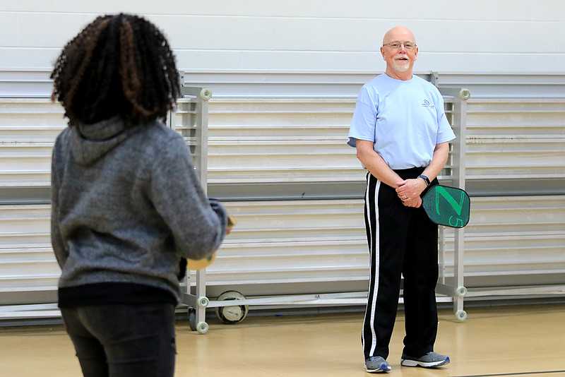 Kids at the Boys and girls club of Fitchburg and Leominster learned about the game of pickleball from some volunteers that love to play. Malika Kallon, 10, from Fitchburg listens to volunteer Richard Meehan as he explains the game. SENTINEL & ENTERPISE/JOHN LOVE