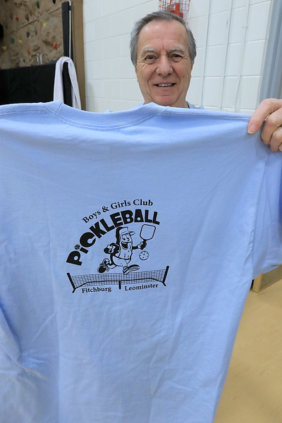 Kids at the Boys and girls club of Fitchburg and Leominster learned about the game of pickleball from some volunteers that love to play. This t-shirt, held by Ron Leger the co-coordinator of the pickleball group, was made by students at Monty Tech. SENTINEL & ENTERPISE/JOHN LOVE