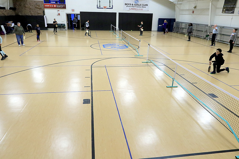 Kids at the Boys and girls club of Fitchburg and Leominster learned about the game of pickleball from some volunteers that love to play. Three nets where set up to play in the B&G Club gym. SENTINEL & ENTERPISE/JOHN LOVE