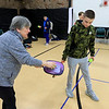 Kids at the Boys and girls club of Fitchburg and Leominster learned about the game of pickleball from some volunteers that love to play. Volunteer Linda McDonald helps Kaiden Drinkwater, 11, from Leominster with his serve, as he learn the game. SENTINEL & ENTERPISE/JOHN LOVE