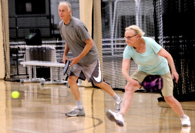 Out on the courts playing Pickleball are locals Alan Jones and Carolyn Sullivan, both from Westford. SUN/David H. Brow