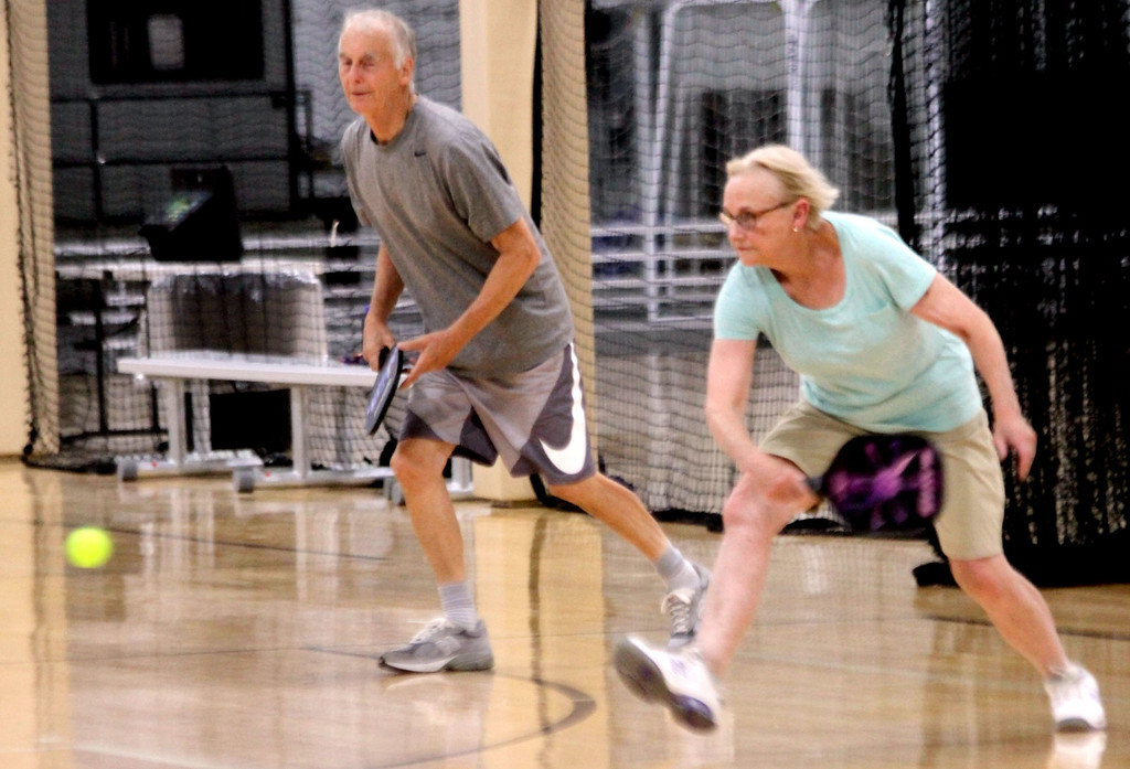 . Out on the courts playing Pickleball are locals Alan Jones and Carolyn Sullivan, both from Westford. SUN/David H. Brow
