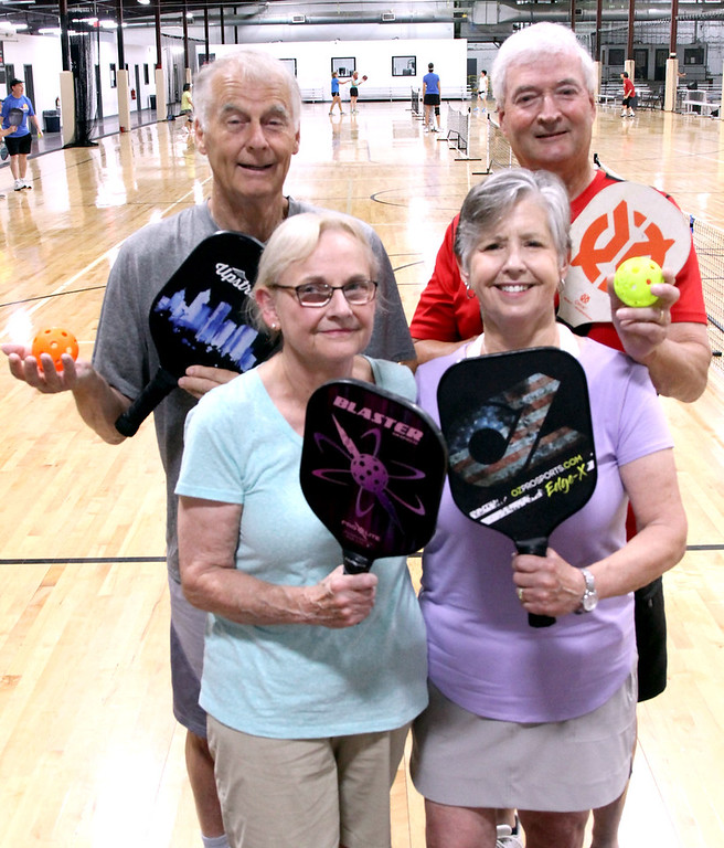 . Showing the right equipment to play Pickleball are locals L-R, Alan Jones, Carolyn Sullivan, Kathy Wilson and Allan Burndrett, all from Westford. SUN/David H. Brow